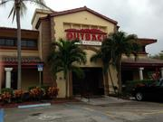 Outback Steakhouse is a tenant at the Shoppes at Village Pointe in Boca Raton.