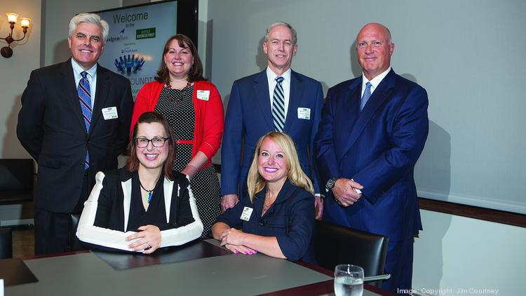 Attorneys representing six Western New York organizations met last month to discuss their jobs as general counsel. Seated, from left: Stephanie Adams of Niagara University and Cheryl Green of The Hamister Group. Standing, from left: Michael Sexton of Roswell Park Cancer Institute, Kristy Berner of First Niagara Financial Group, Stephen Sloan of Univera Health and John Mineo of Independent Health.