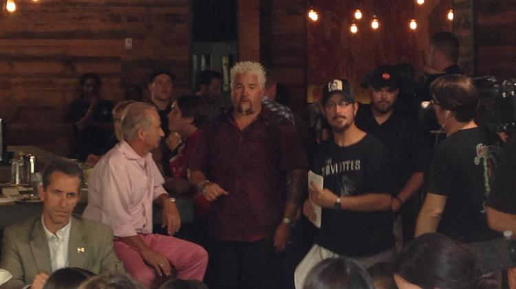 Guy Fieri was filming at Bakersfield OTR, surrounded by crew members and guests digging into the restaurant's tacos, guacamole and boots full of beer.