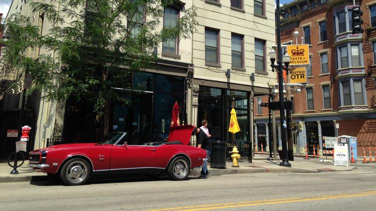 Guy Fieri's red 1968 red Camaro was parked in front of Taste of Belgium on Wednesday.
