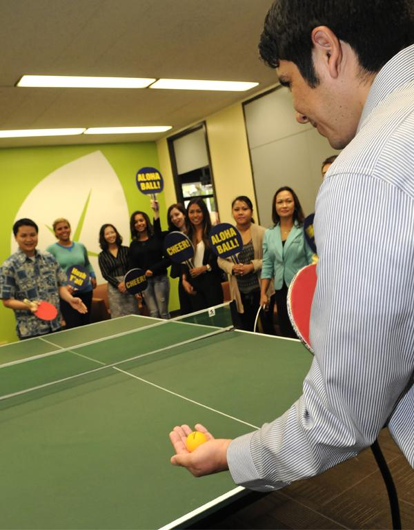 American Savings Bank is a leader in the creative use of employee perks, including ping pong breaks. Herman Jopia, right, data analytics manager - marketing, serves to Ken Wong, human resources information systems supervisor, as ASB employees cheer them on.