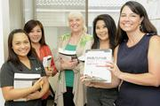 ProService Hawaii employees prepare to take the Professional Human Resources certification test. From left are Agnes Okuma, Tami Minami, Bea Bea Reinbachs, Angie Nakasone and Sarah Guay. The human resource firm says it is offering its 120 employees many of the benefits that larger companies would provide.
