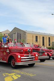 Antique fire trucks from the Louisville Fire Department rolled down Broadway in the Pegasus parade.