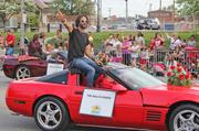 Rami Jaffeee keyboardist of The Wallflowers rides in the Pegasus parade with his other bandmates.