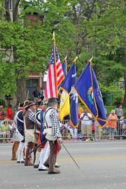 The National Sons of the American Revolution presented flags as they walked the route.