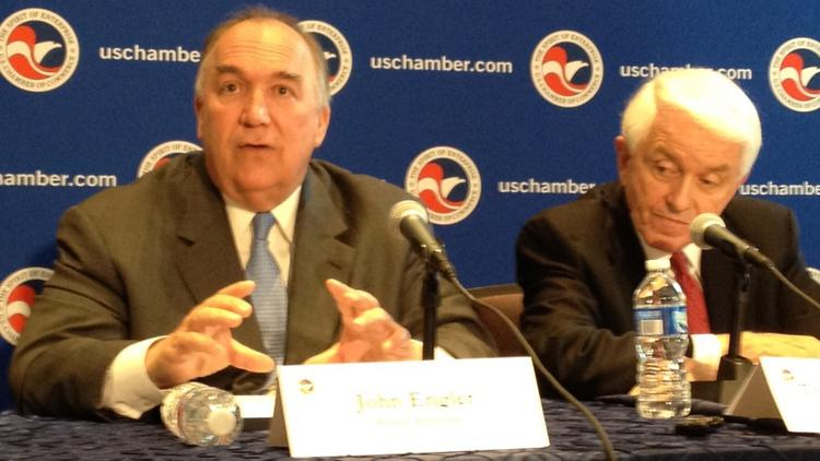 Business Roundtable President John Engler, left, makes an economic case for immigration reform as U.S. Chamber of Commerce President and CEO Tom Donohue listens.