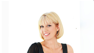 Susan Costanza wearing her detachable sleeve product Sleeves 2 Go.