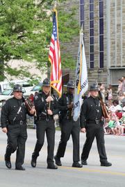 Several police officers and firefighters marched in the parade.