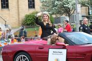 Mallory Hagan, Miss America 2013, waves to the crowds lining the parade route.