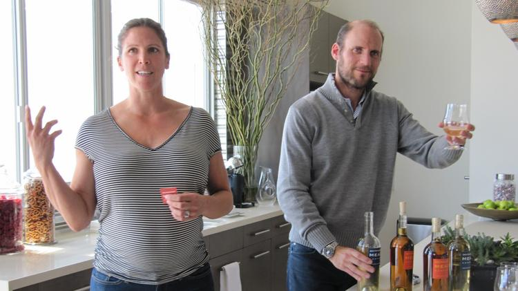 Sarah Benary (left) and her husband, Oron Benary, make mead, an alcoholic beverage made from honey, in the Bayview in San Francisco. Here they are displaying their products in the sales center at Lennar Urban's San Francisco Shipyard, a new housing development.