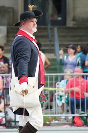 The National Sons of the American Revolution, dressed in period clothing, marched along the parade route.