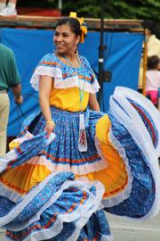 Dancers followed the Latino Citizens Police Academy float in the parade.