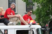 Luke Hancock and Peyton Siva, members of the U of L men's basketball team enjoy the ride along the parade route.