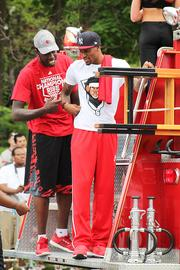 University of Louisville basketball players Montrezl Harrell and Kevin Ware rode on the back of a fire truck carrying the rest of the team, who served as grand marshals of the parade.