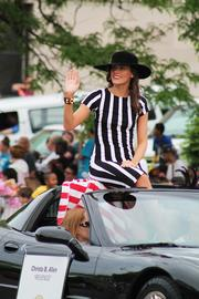 "Actress Christa B. Allen from ABC's ""Revenge"" waves at the crowd during the parade."