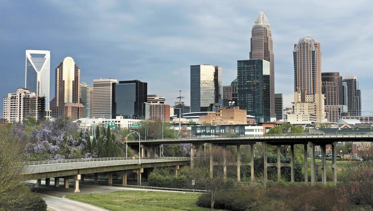 Charlotte is making progress on key issues such as energy use, air quality, transportation and water use, but it's regressing on land use and food access, according to a new report.