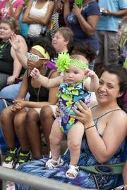 Lashay West held her daughter Mia Darville up for a better view of the parade.