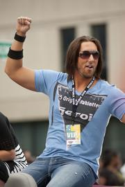 Country artist J.D. Shelburne pumped his fist while riding in a car in the parade.