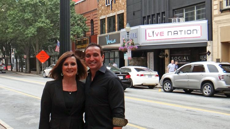 Greensboro Mayor Nancy Vaughan, left, with restauranteur and nightclub proprietor Rocco Scarfone. The black building in the background is where the venue that will be exclusively booked by House of Blues Entertainment will be located.