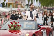 "Gunnar Deatherage, a former contestant on Lifetime's ""Project Runway"" waved to crowds."