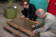 Hillsborough County Commissioner Ken Hagen and Mayor Bob Buckhorn sign their names to a cement piece of the Epicurean – a culinary-themed boutique hotel being developed by Mainsail Lodging & Development in collaboration with Bern's Steak House in Tampa.