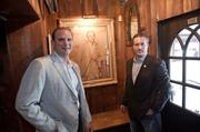 "At the restaurant's entrance Bronson Trebbi, owner, and Donny Arnsperger, managing partner/GM, pose with a painting titled ""The Country Gentleman."""