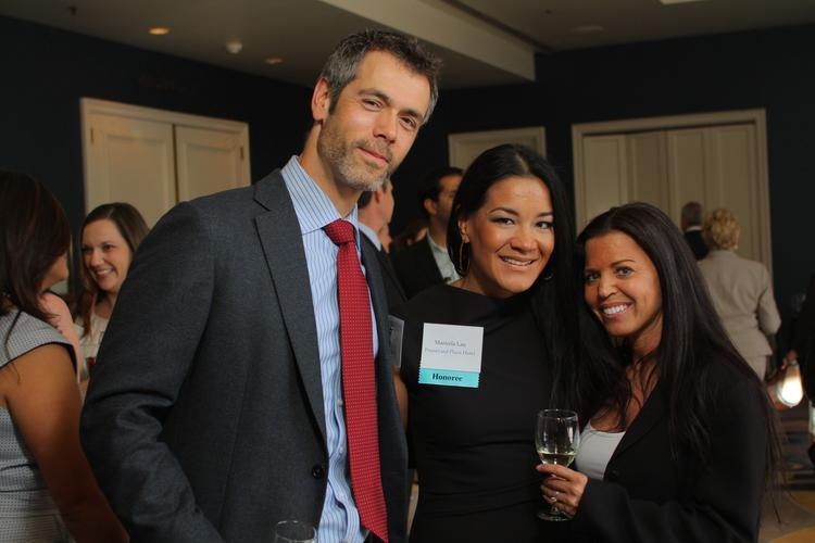 Gilead Sciences' Dan Prudhomme, honoree Maricela Lau with the Pruneyard Plaza Hotel, and Larkspur Hotels' Melissa Prince socialize before the Women of Influence awards dinner.