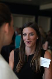 Gutenberg Communication's Veronica Olah chats with another guest.