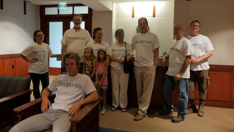 """Arizona Corporation Commission candidate Jim Holway (second from left in back) stands in the governor's office reception area with volunteers and his son Joseph Holway (front, seated). The group was turning in """"no solar tax"""" online petition signatures."""