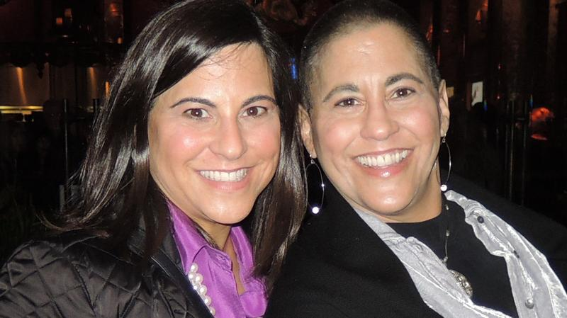 Dana Manciagli (left) and her identical twin sister, Tracy, who died of breast cancer in May.