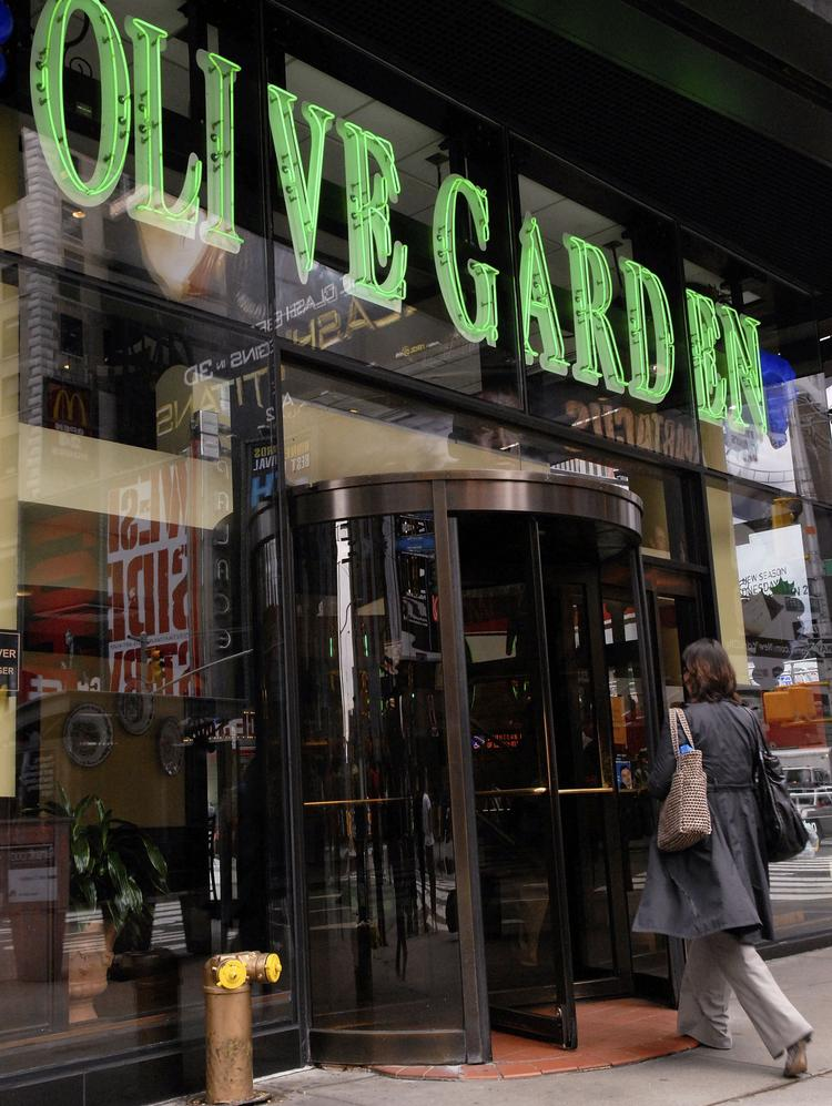 a woman enters an olive garden restaurant in times square - Olive Garden New York