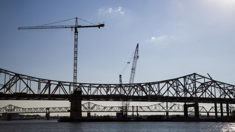 Cranes work near the existing bridges in the downtown corridor of the Ohio River Bridges Project.