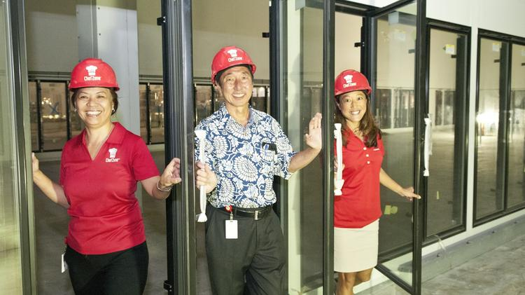 From left, Jackie Cabebe, general manager and restaurant supply specialist; Russell Hata, chairman of Y. Hata & Co. and founder and president of ChefZone; and Margot Sakazaki, development director for ChefZone, step out of what will be a 4,600-square-foot freezer at the new ChefZone wholesale warehouse that is being built at 2888 Ualena St. near the Honolulu International Airport.