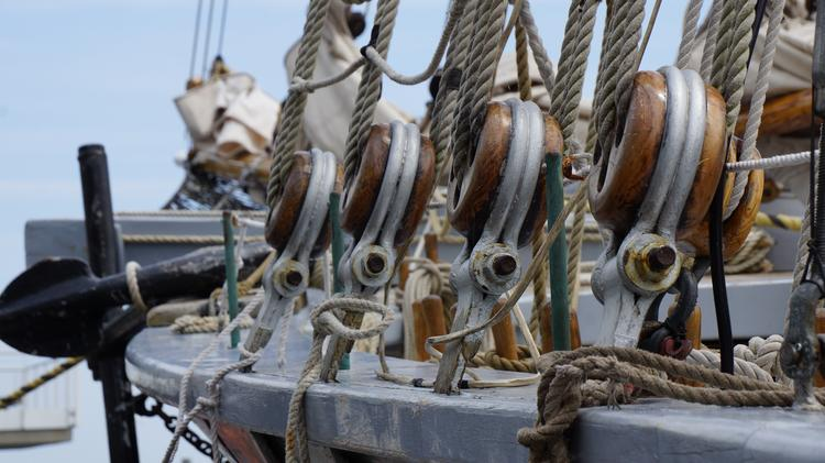 Row of wood pulleys near the anchor