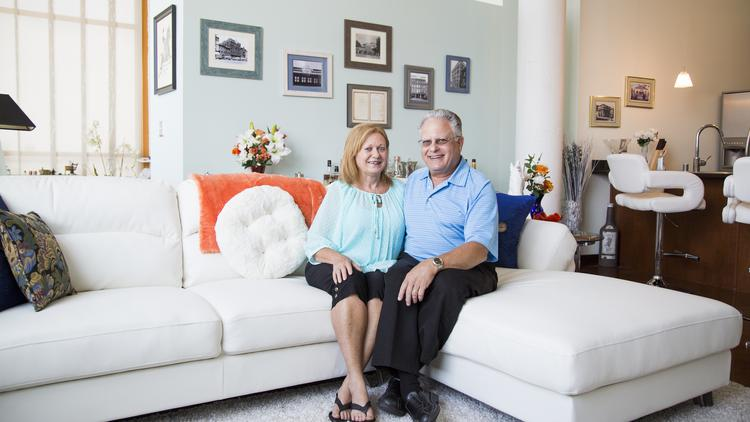 Janet and Richard Rosenbaum sit inside their loft unit in the Mercantile Gallery Lofts building. Richard Rosenbaum's great-great-grandfather, Isaac Rosenbaum, once owned the building.