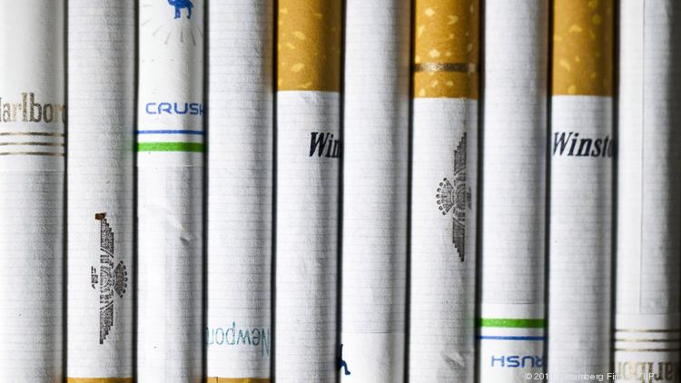 Various cigarettes are arranged for a photograph in New York, U.S., on Thursday, April 14, 2011. Tobacco companies, including Altria Group Inc.'s Philip Morris USA unit, asked a judge last month to dismiss the federal government's 1999 racketeering case, saying court oversight of the industry is no longer needed. Photographer: Chris Goodney/Bloomberg