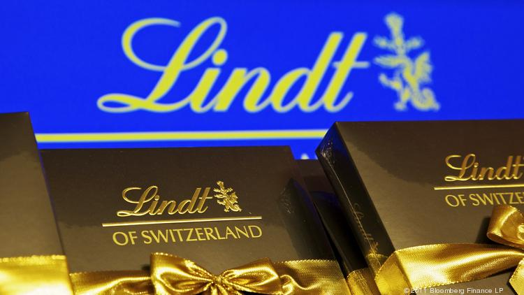 Lindt chocolate products sit on display inside the Lindt & Sprungli AG store at the company's factory in Kilchberg, near Zurich, Switzerland.