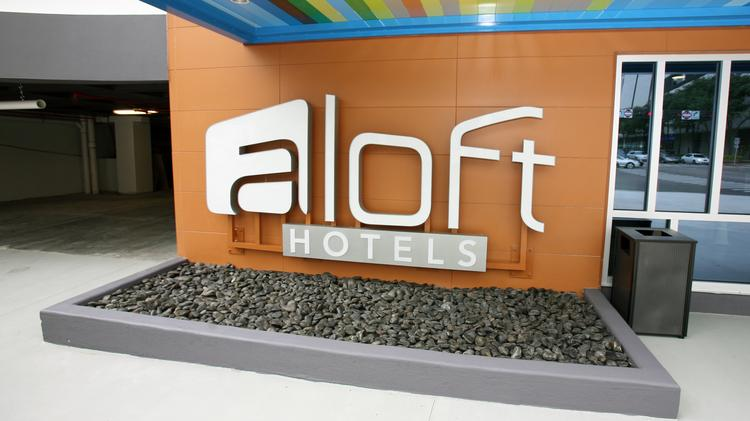 Aloft Tampa Downtown is days away from opening and never closing. As of the grand opening July 17, 60 to 70 of the hotel's 130 rooms will be available. This image is at the street level front of the hotel. If you want to go check it out, there will be only valet parking. But best bet if you want to self park: use the Fort Brooke lot and walk through the third floor skyway and through the Hilton to Tampa Street. It's a block to the west.