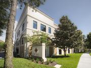 Valencia College moved into its new administration building, pictured here, back in June, which allowed the downtown building's sale to close on July 15.