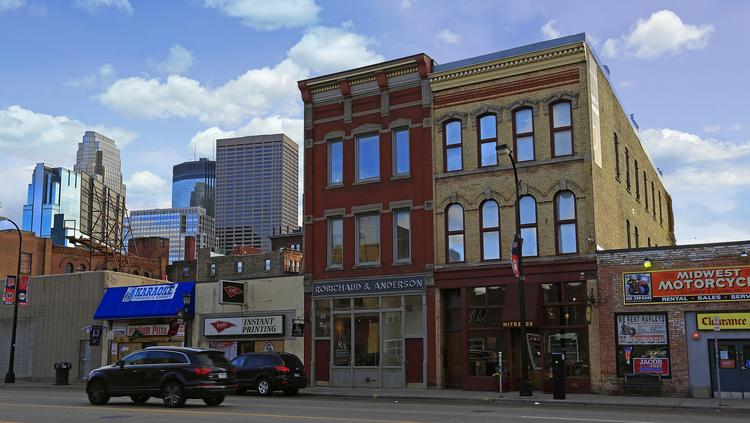 Jostens CEO Chuck Mooty has purchased the red three-story building at 211 Washington Ave. N.