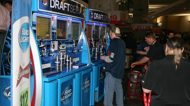 Fans poured beers at the new DraftServ stations at Target Field.