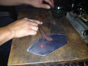 A freshly rolled cigar demonstration at State Social House