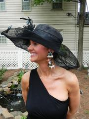 Meredith Carbrey showed off her Derby hat and earrings at the Warrens' garden party.
