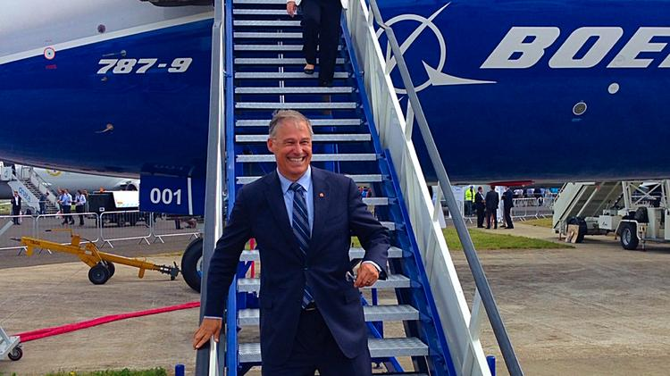 A happy Gov. Jay Inslee descends the stairs of a Boeing 787-9, which was one of the stars of the Farnborough Air Show outside London. Inslee credits the Machinists' Union vote in January for Washington state's resurgence.