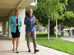 Apple teams with IBM to sell mobile, cloud apps to business customers