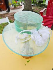 Hats created by Gayl Leathers and Annabelle Woody served as centerpieces at the Warrens' Old Louisville garden party on Thursday.
