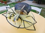 A yellow and black hat, created by Gayl Leathers and Annabelle Woody, made a festive centerpiece on one of the tables at the garden party.
