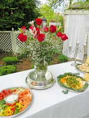 A centerpiece of classic Derby red roses was displayed with the hors d'oeuvres served at the DuPont Mansion party.