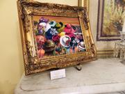 One of Louisville artist Ken Boatright's oil paintings features Derby hats worn by patrons at Churchill Downs.
