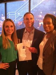 The American Marketing Association held its April Networker event on the 23rd at Crossroads restaurant. Nicole Wolfert of CFP Board won a raffle card drawing and gift certificate from Crossroads, and is joined here by AMA President-elect Brian Rutter and Crossroads Manager Odette Lee.